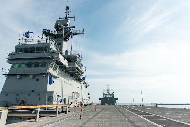 Large battle ship in naval base Premium Photo