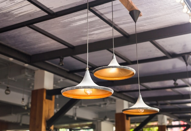 Large chandelier lamps in a cafe Premium Photo