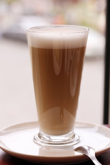A large glass of cold coffee Free Photo