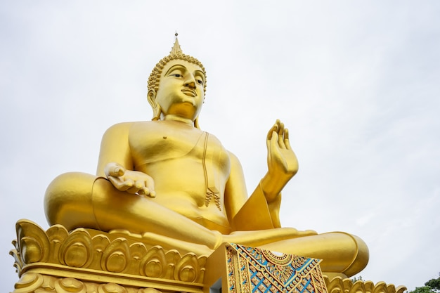 The large golden buddha statue stands tall Premium Photo