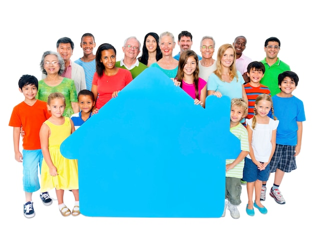 Large group of people holding home symbol Free Photo