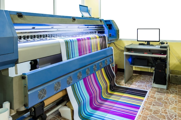 Large inkjet printer multicolor cmyk working on vinyl banner with computer control Premium Photo