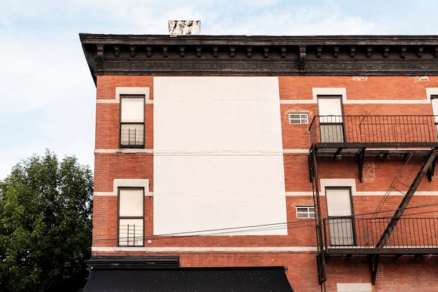 Large mock-up billboard on a building Free Photo