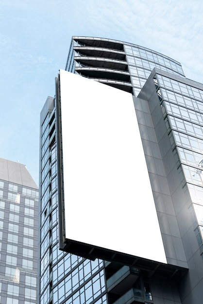 Large mock-up billboard on a city building Premium Photo