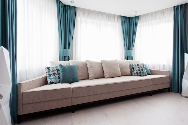 Large modern couch in the room Premium Photo