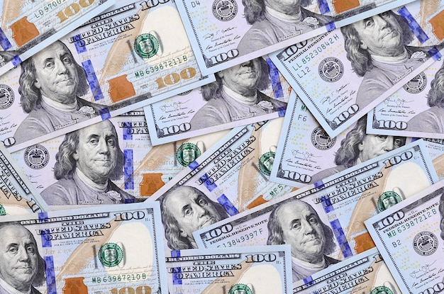 A large number of us dollar bills of a new design with a blue stripe in the middle. top view Premium Photo