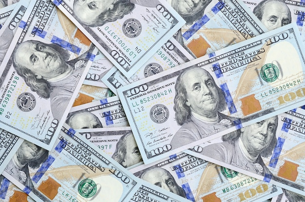 A large number of us dollar bills of a new design Premium Photo