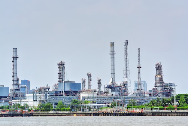 Large oil refinery plant by the river Premium Photo