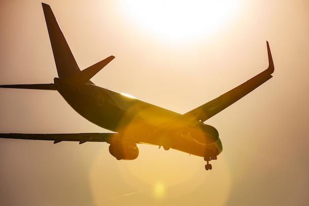 Large passenger plane flying in the blue sky Premium Photo