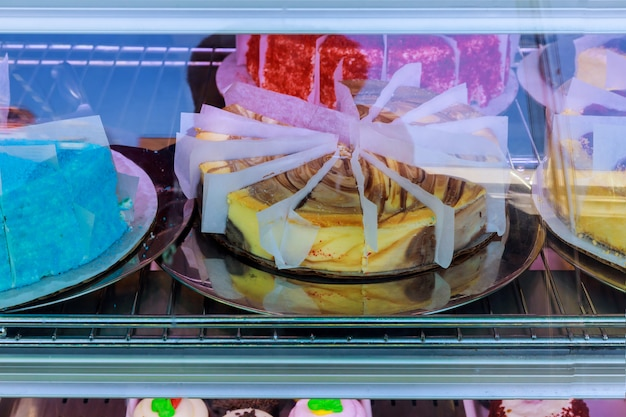 Large selection of cakes and pastries on the counter in a cafe. sale of delicious sweets. Premium Photo