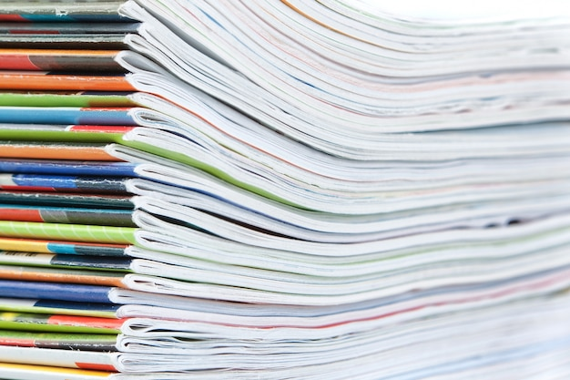 A large stack of colorful magazines. close-up. Premium Photo