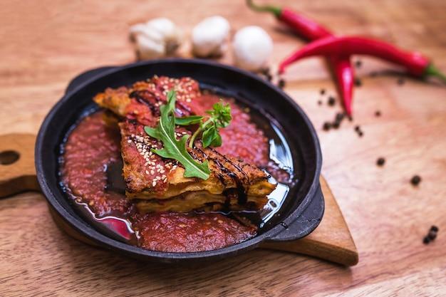 Lasagna bolognese in a hot frying pan Premium Photo
