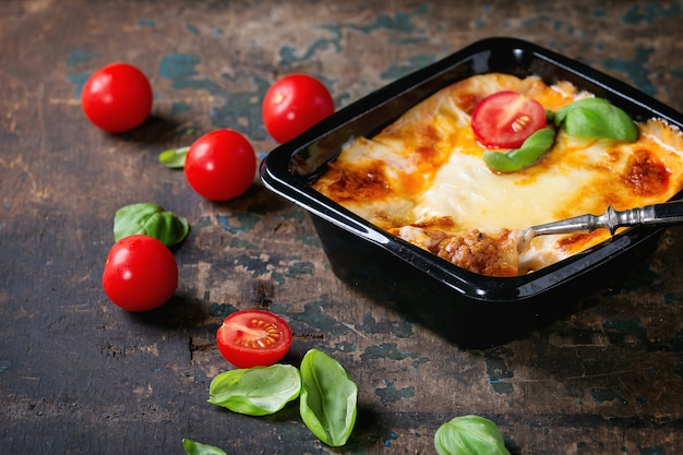 Lasagna in plastic box Premium Photo