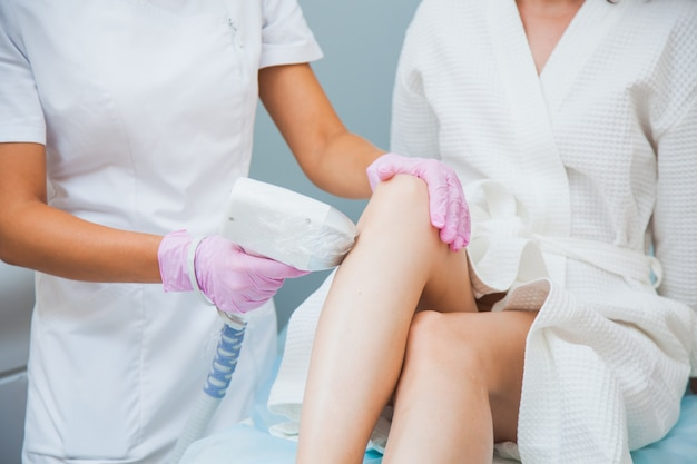 Laser hair removal in a clinic Premium Photo
