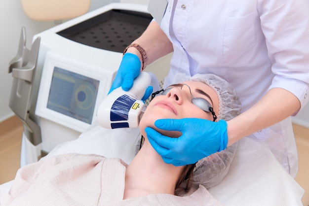 Laser procedure in the clinic of laser cosmetology. Premium Photo
