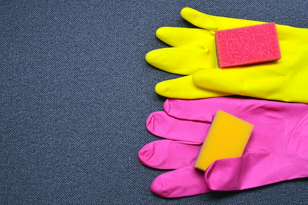 Latex cleaning gloves and sponges.cleaning equipment.cleaning concept with supplies. Premium Photo