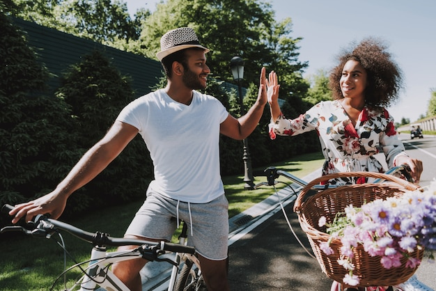Latin couple on cycling in a romantic date Premium Photo