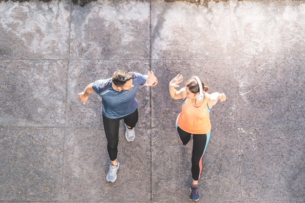 Latin couple running or jogging together outdoors. Premium Photo