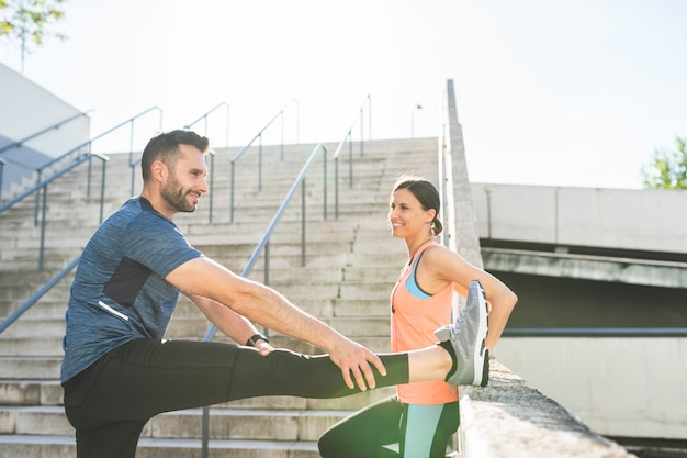 Latin couple stretching together outdoors Premium Photo