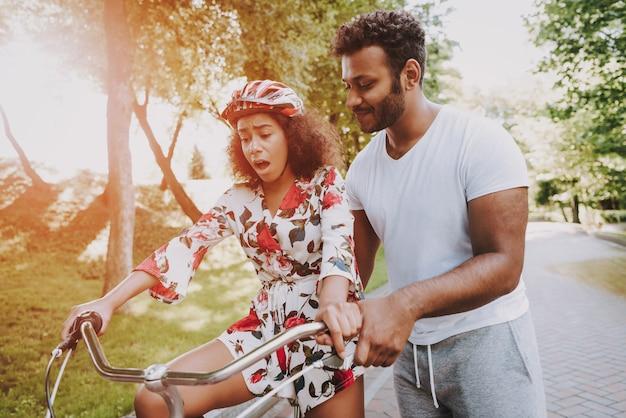 Latin guy is teaching wife to cycle Premium Photo