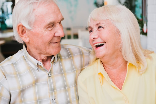 Laughing delighted senior couple Free Photo