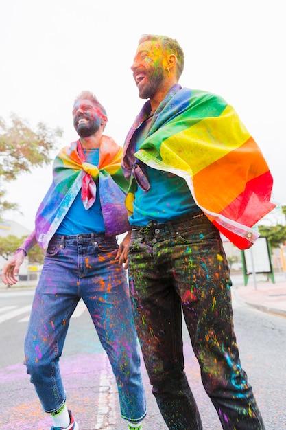 Laughing gays enjoying holi festival Free Photo