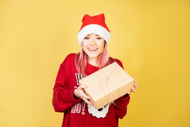 Laughing girl with gifts in hands Free Photo