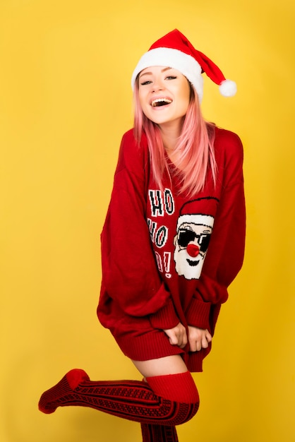 Laughing girl with red santa suit Free Photo