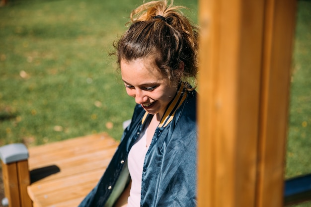 Laughing teen student resting at sportsground Free Photo