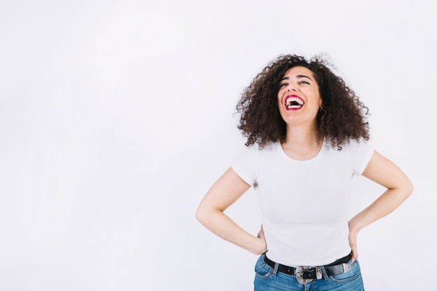 Laughing woman with curly hair Free Photo