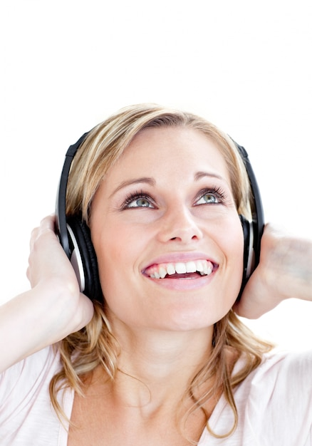 Laughing woman with headphones against white background