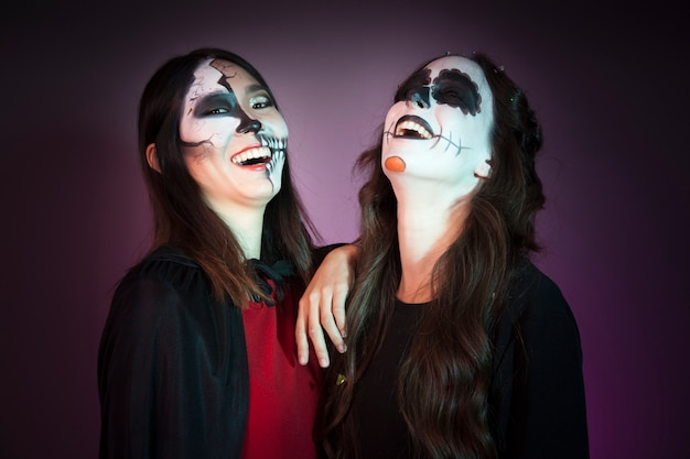 Laughing women dressed as witches Free Photo