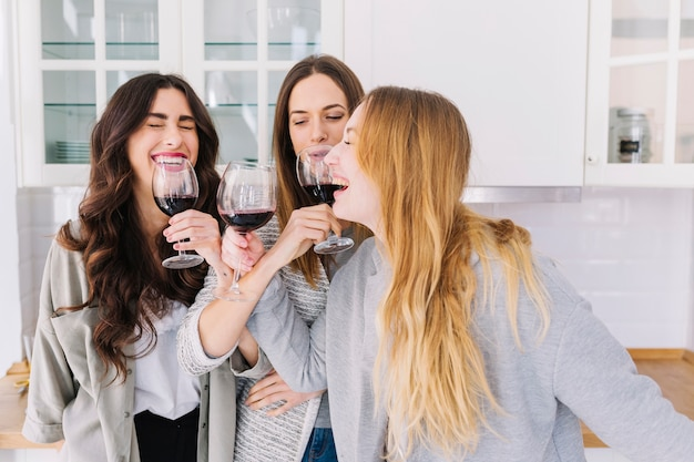 Laughing women drinking wine Premium Photo