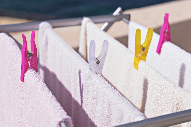 Laundry hangs on the dryer Premium Photo