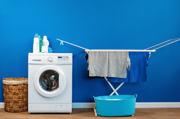Laundry room interior with washing machine and clothes dryer near wall Premium Photo