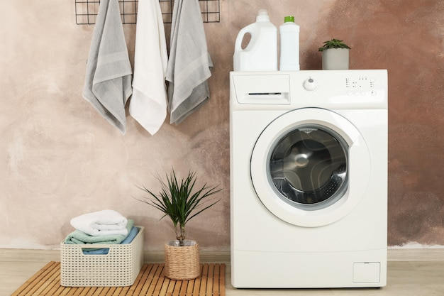 Laundry room with washing machine against brown wall Premium Photo