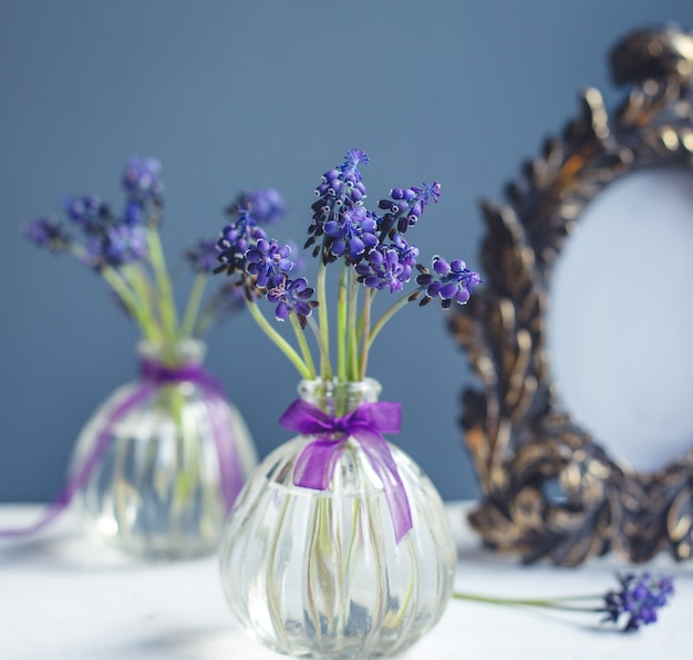 Lavander branches inside small pretty flask vase Free Photo