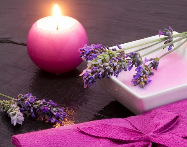 Lavender shampoo with scented candle Premium Photo
