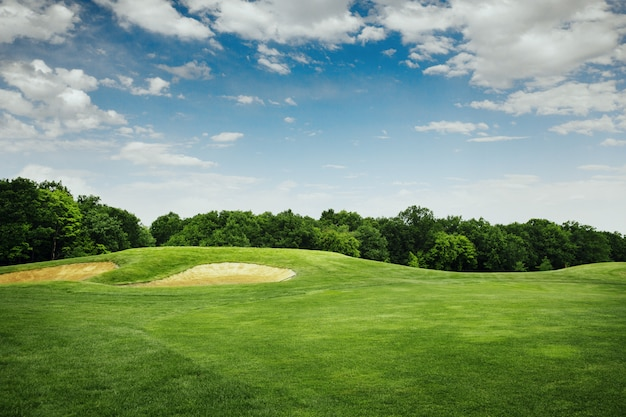 Lawn and sand bunkers for golfing on golf course Premium Photo