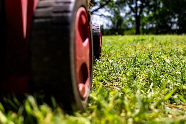 Lawnmover in the green field Premium Photo