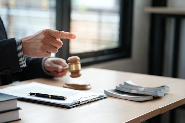 Lawyer auction bid sale judgment mallet with judge. auctioneer knocking down sale. Premium Photo
