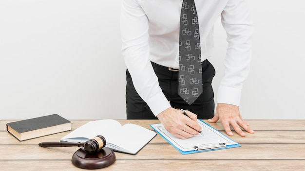 Lawyer filling form Free Photo