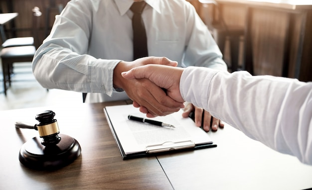 Lawyer handshake with client. business partnership meeting successful concept. Premium Photo