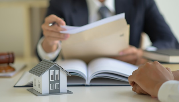 The lawyer is consulting clients about the house purchase contract. Premium Photo