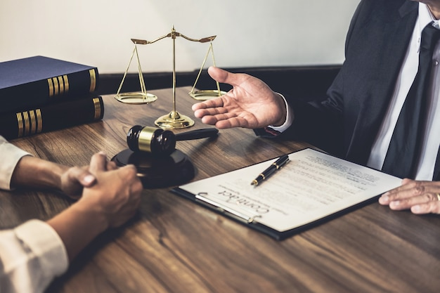 Lawyer or judge counselor having team meeting with client, law and legal services Premium Photo