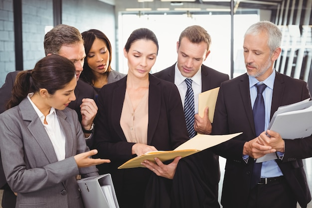 Lawyer looking at documents and interacting with business people Premium Photo