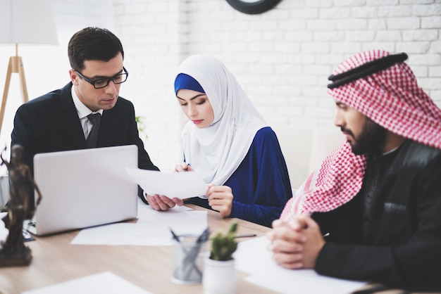 Lawyer in office with arab husband and wife. Premium Photo
