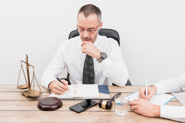 Lawyer with client Free Photo