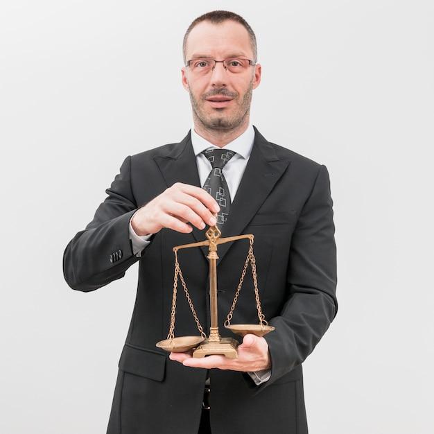 Адвокат с весовыми шкалами Premium Фотографии