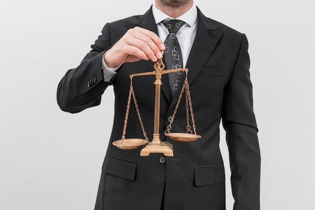 Lawyer with weighing scales Free Photo